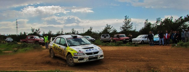 Rally car competition, transportation traffic.