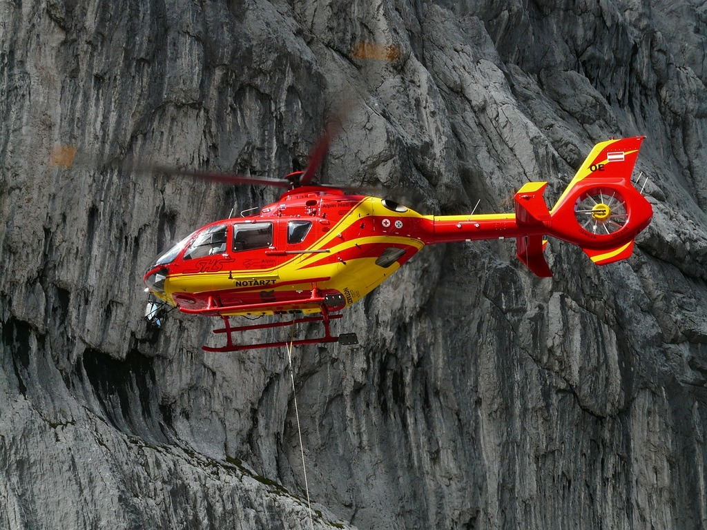 Rescue helicopter colours red.
