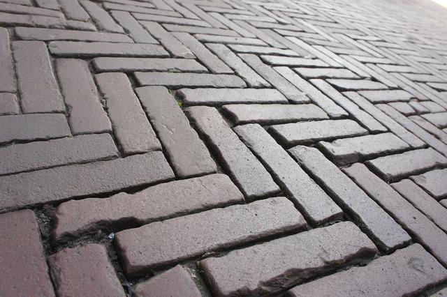 Road paving stones mosaic, transportation traffic.