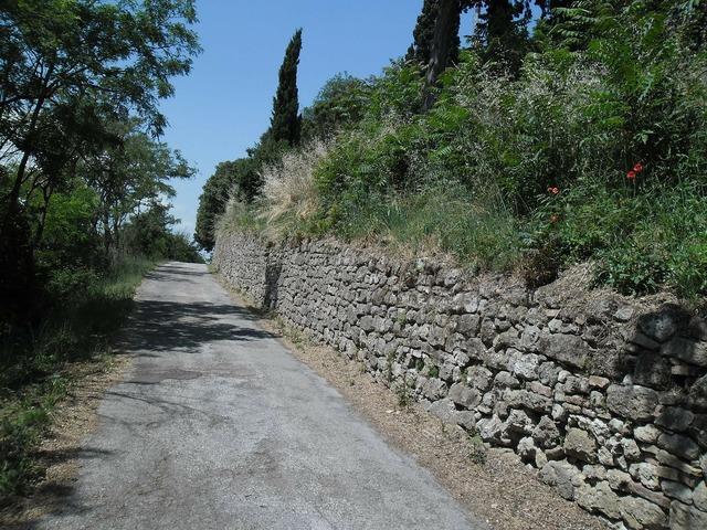 Road wall upstream, transportation traffic.