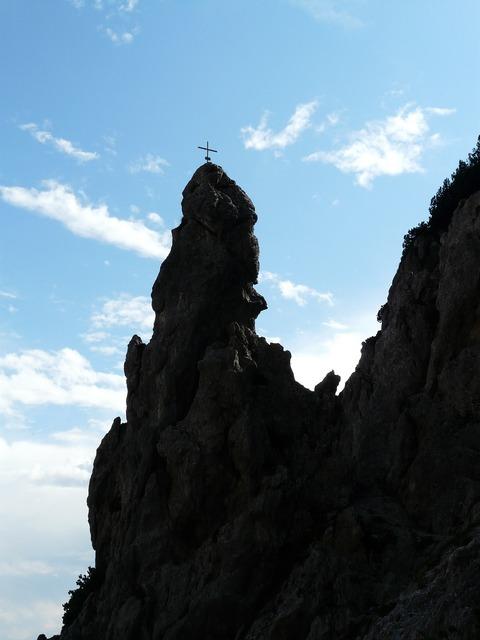 Rock tower cross summit cross.