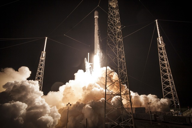 Rocket launch night countdown, transportation traffic.