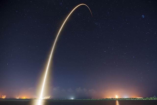 Rocket launch night trajectory, transportation traffic.