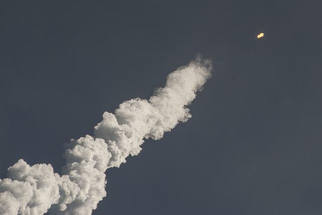 Rocket launch steam smoke, transportation traffic.