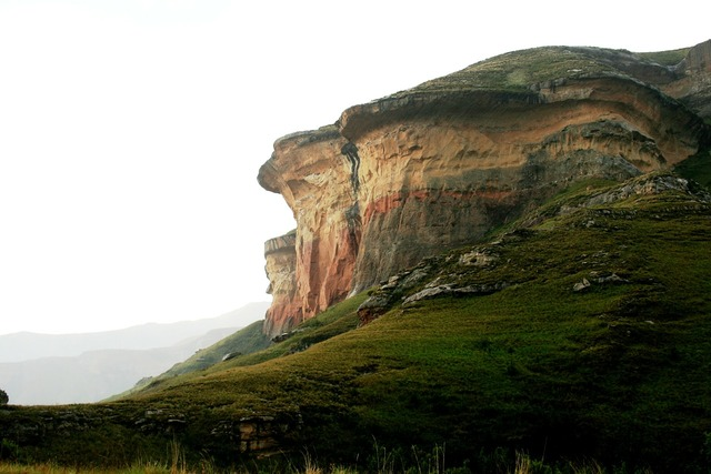 Rockface sandstone gold-pink earthy colors, nature landscapes.