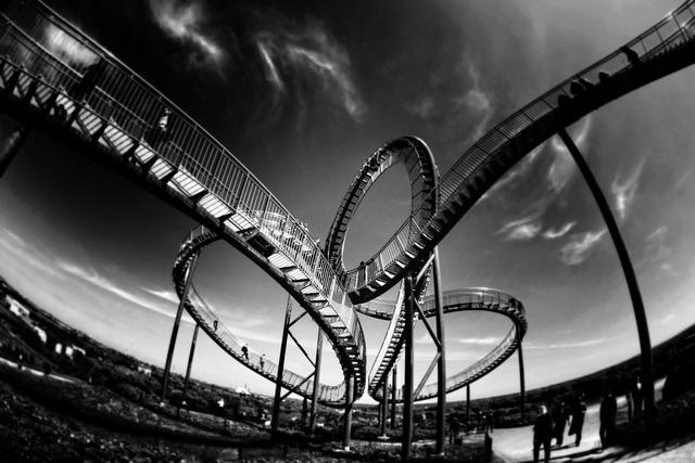 Rollercoaster looping amusement.