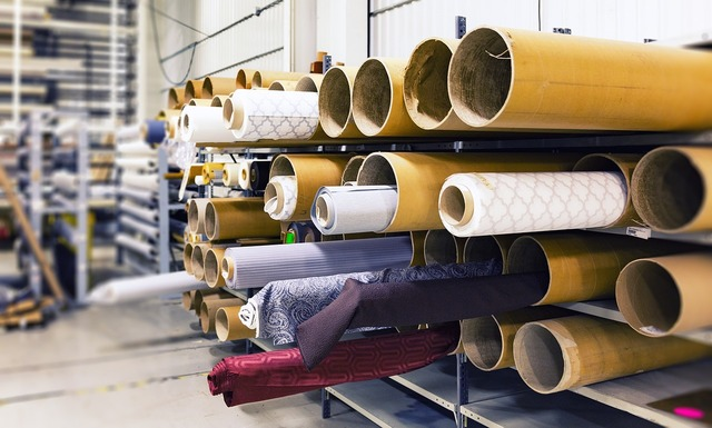 Rolls of fabric factory material, industry craft.