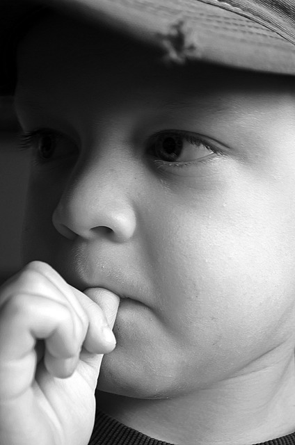 Sad child boy, emotions.