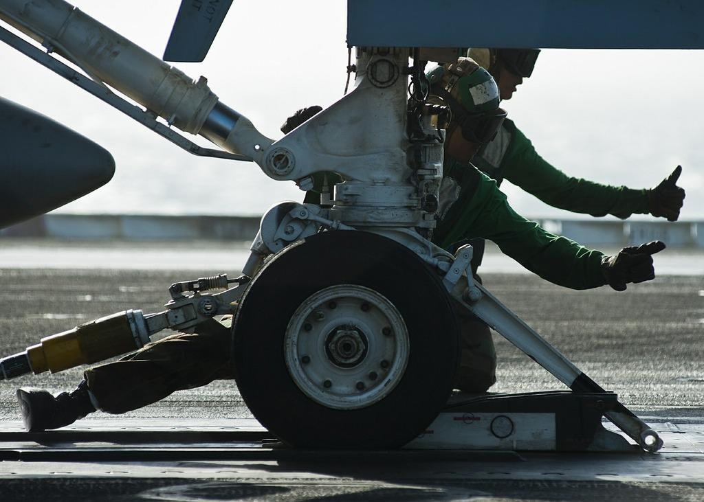 Sailors crew catapult operations.