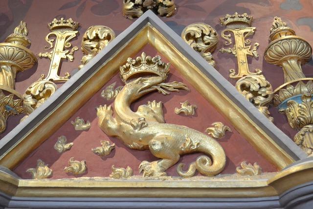 Salamander emblem of king monogram.
