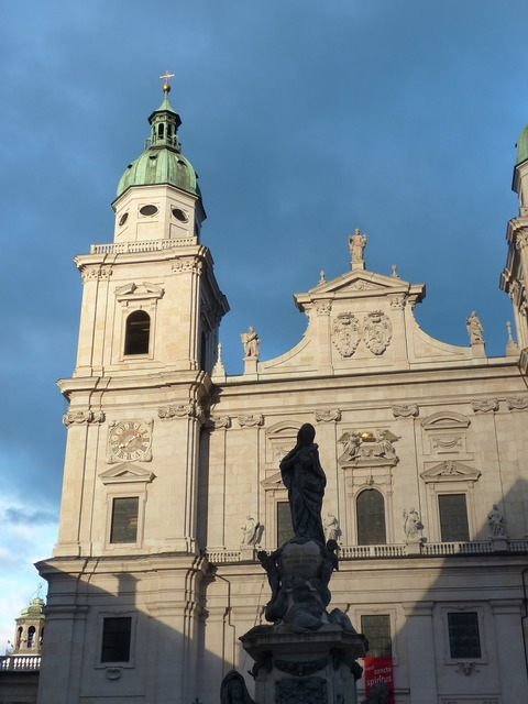 Salzburg cathedral facade evening sun, religion.