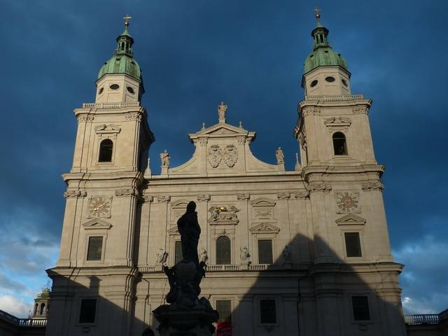 Salzburg cathedral facade evening sun, religion.