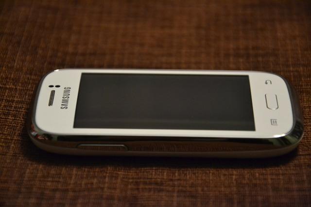 Samsung white phone, computer communication.
