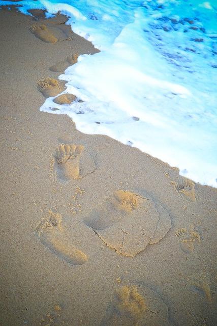 Sand beach footprints, travel vacation.