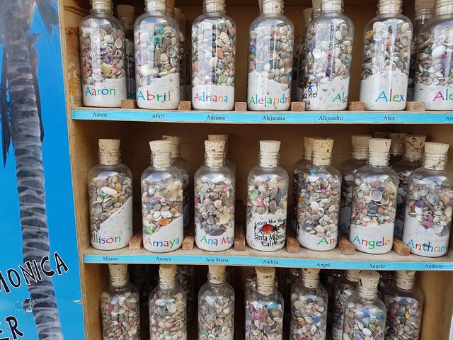 Sand glass bottles souvenirs, travel vacation.
