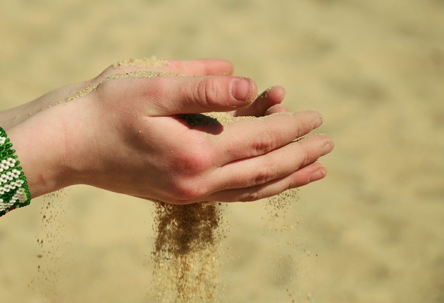 Sand hands melt away, travel vacation.