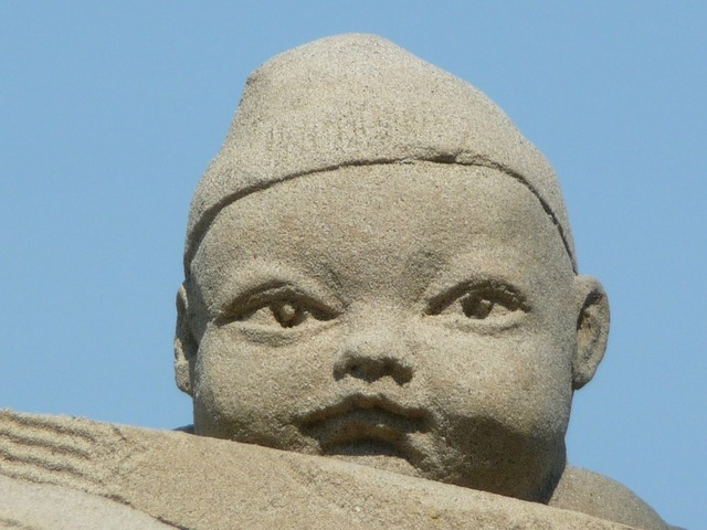Sand sculpture baby face.