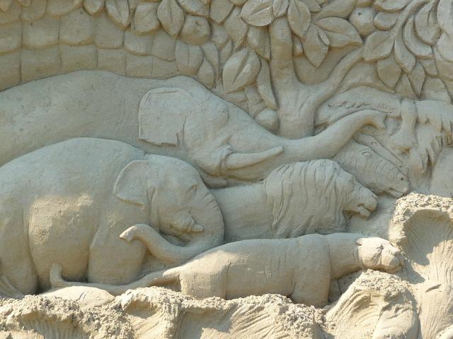 Sand sculpture elephant face.