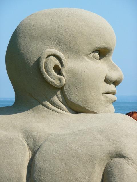 Sand sculpture man face, people.