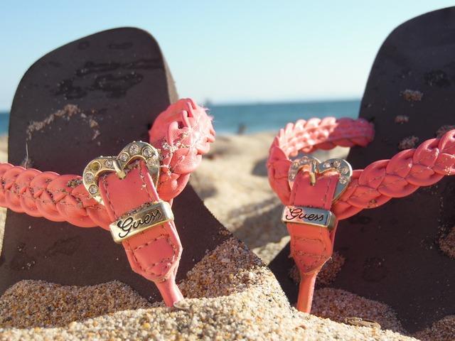 Sandals beach sand, travel vacation.