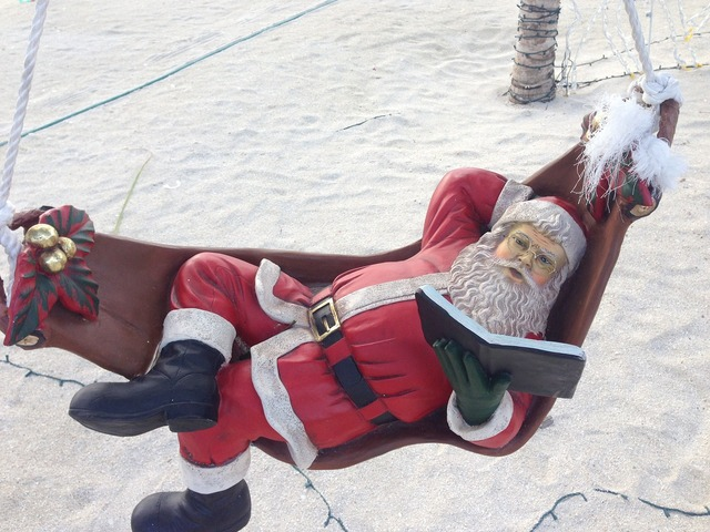 Santa claus read book, travel vacation.