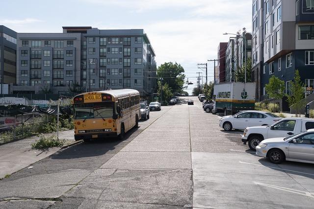 School bus uphill road road, transportation traffic.