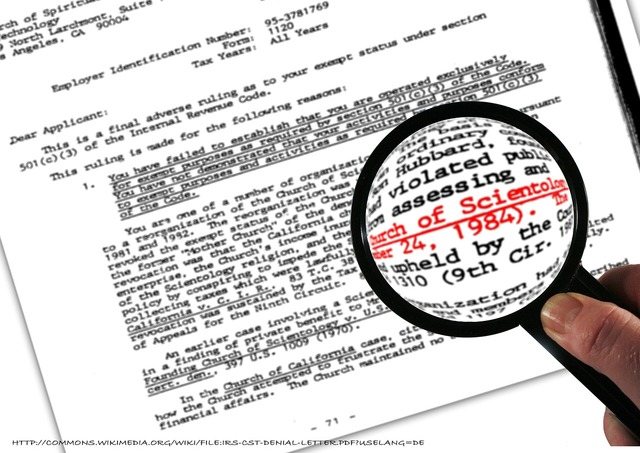 Scientology letters magnifying glass, religion.