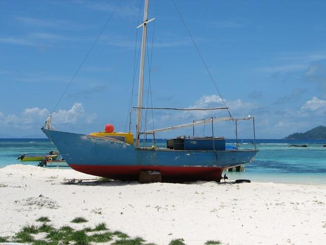 Seychelles boat beach, travel vacation.