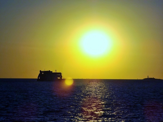 Ship sunset silhouette, travel vacation.