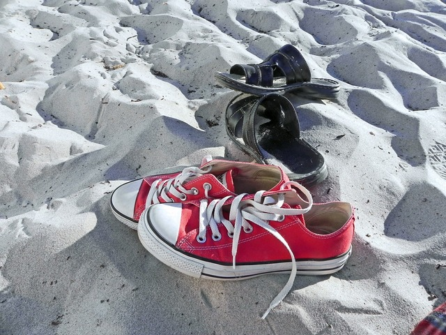 Shoes beach sand, travel vacation.