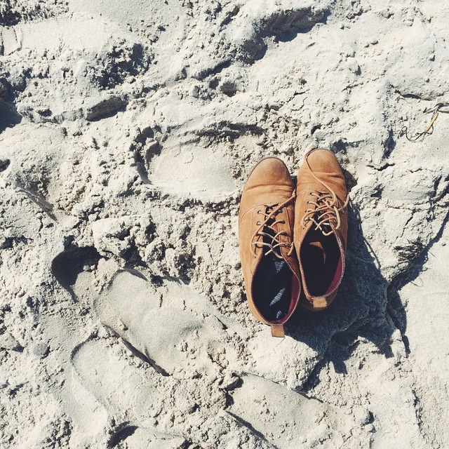 Shoes boots sand, travel vacation.