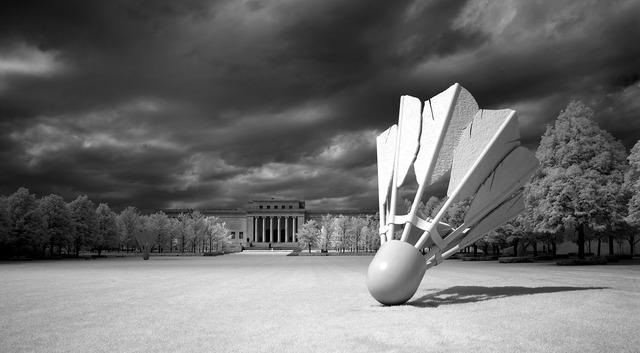 Shuttlecock sculpture outdoors artwork.