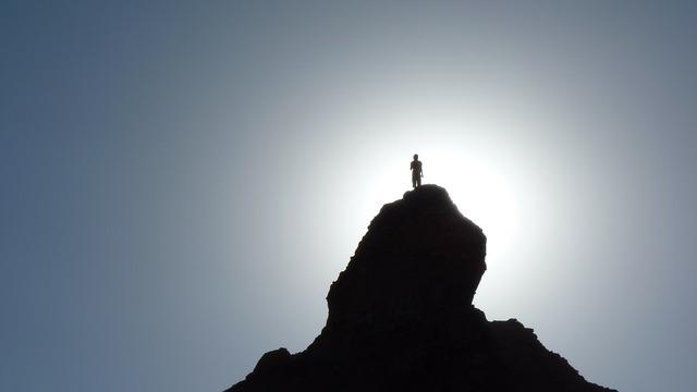 Silhouette hiker mountain top.