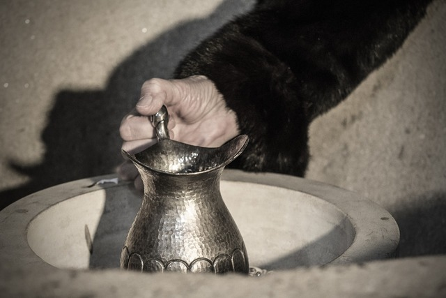 Silver tankard woman's hand old, religion.