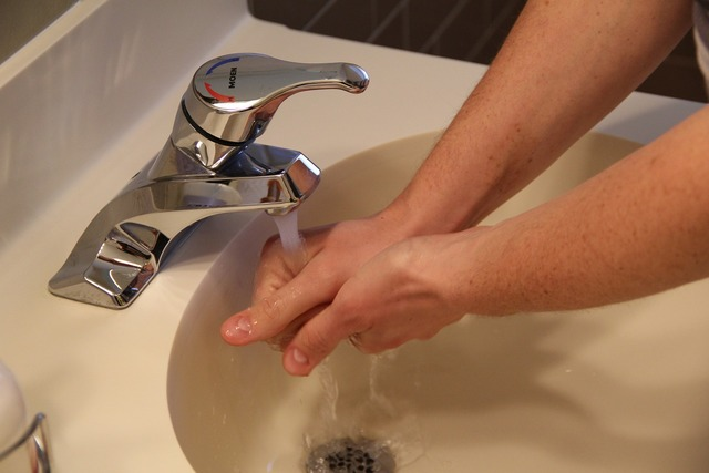 Sink washing hands water, people.