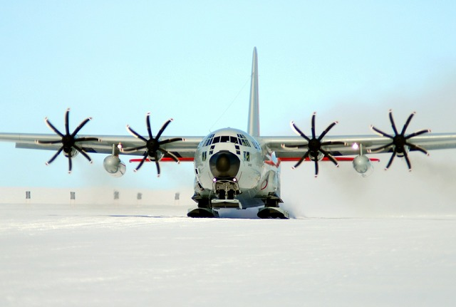 Ski equipped cargo plane military aircraft.