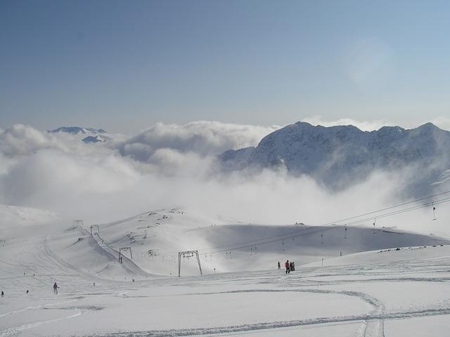 Ski piste slope skiing.