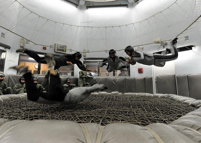 Skydiving indoors training, people.