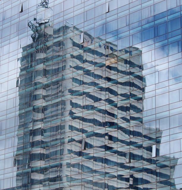 Skyscraper mirroring mirror wall, architecture buildings.