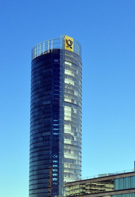 Skyscraper posttower telecom tower, computer communication.