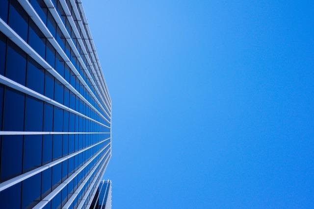 Skyscraper windows vertical, architecture buildings.