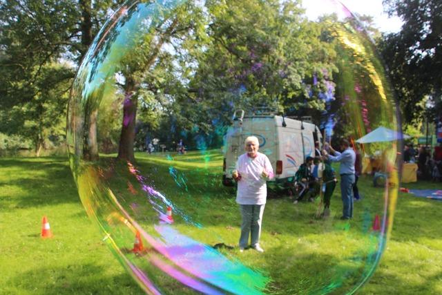 Soap bubbles large human.
