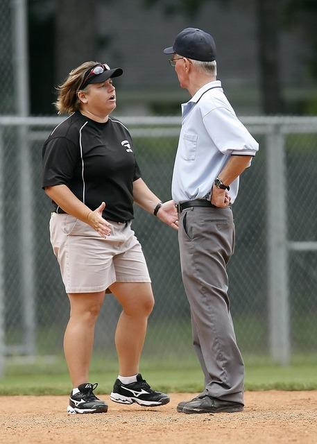 Softball coach umpire.