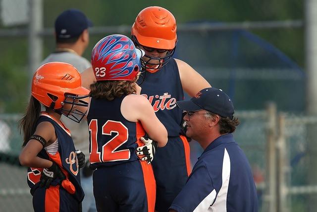 Softball team coach.
