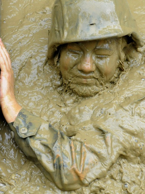 Soldier jungle training mud pit, beauty fashion.