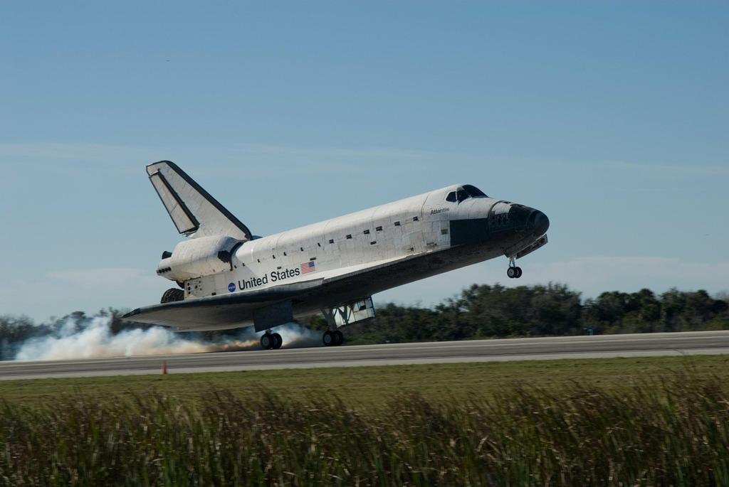 Space shuttle landing astronautics, science technology.