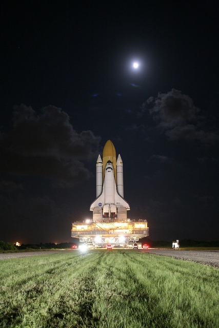 Space shuttle rollout moon, transportation traffic.