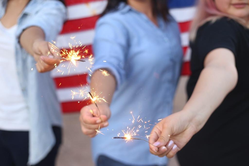 Sparklers burning fireworks, people.