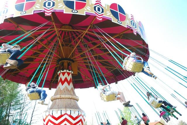 Spinning amusement park swings.