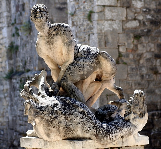 Statue man dragon, people.